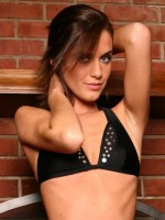 All Over Lexi in a sexy black outfit by the fireplace
