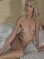 Skinny blonde girl naked in bed