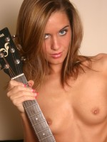 Lexi plays her guitar fully nude