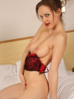 Tina Kay removes her red and black lingerie to show off her body